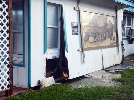 The side of a home was almost blown off after Hurricane