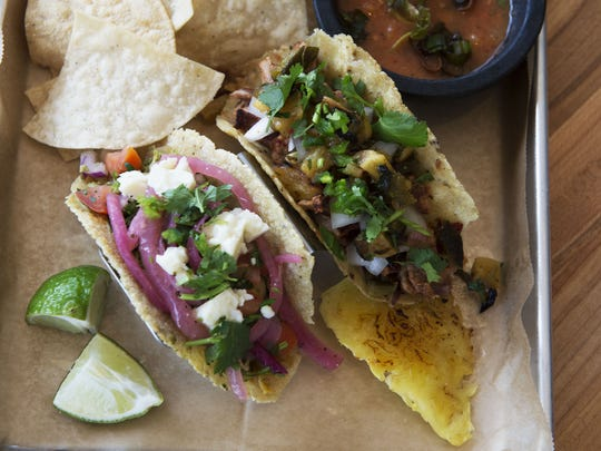 A pair of tacos sit ready at Mamacita's Taco Temple, located at 132 Charlotte Street.