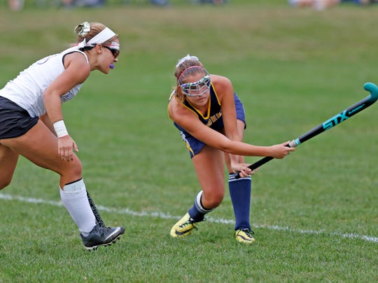 Elco's Katie Fields passes the ball to a teammate at