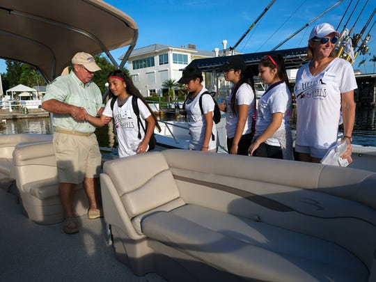 Boat captain Scott Wilkins, of Bonita Springs, left, welcomes participants Yessica Moctezuma, Nicole De La Cruz, Isabel Arroyo and Janetzi Jimenez and event chairperson Lauren Boyle to his boat during the Freedom Waters FoundationÕs Heels and Reels Fishing Tournament on Saturday, Oct. 8 2016 at the Naples Boat Club in Naples.