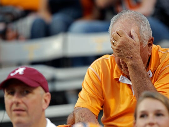 A Tennessee fan can't watch during the second half of an NCAA college football game against Alabama Saturday, Oct. 15, 2016, in Knoxville, Tenn. Alabama won 49-10.