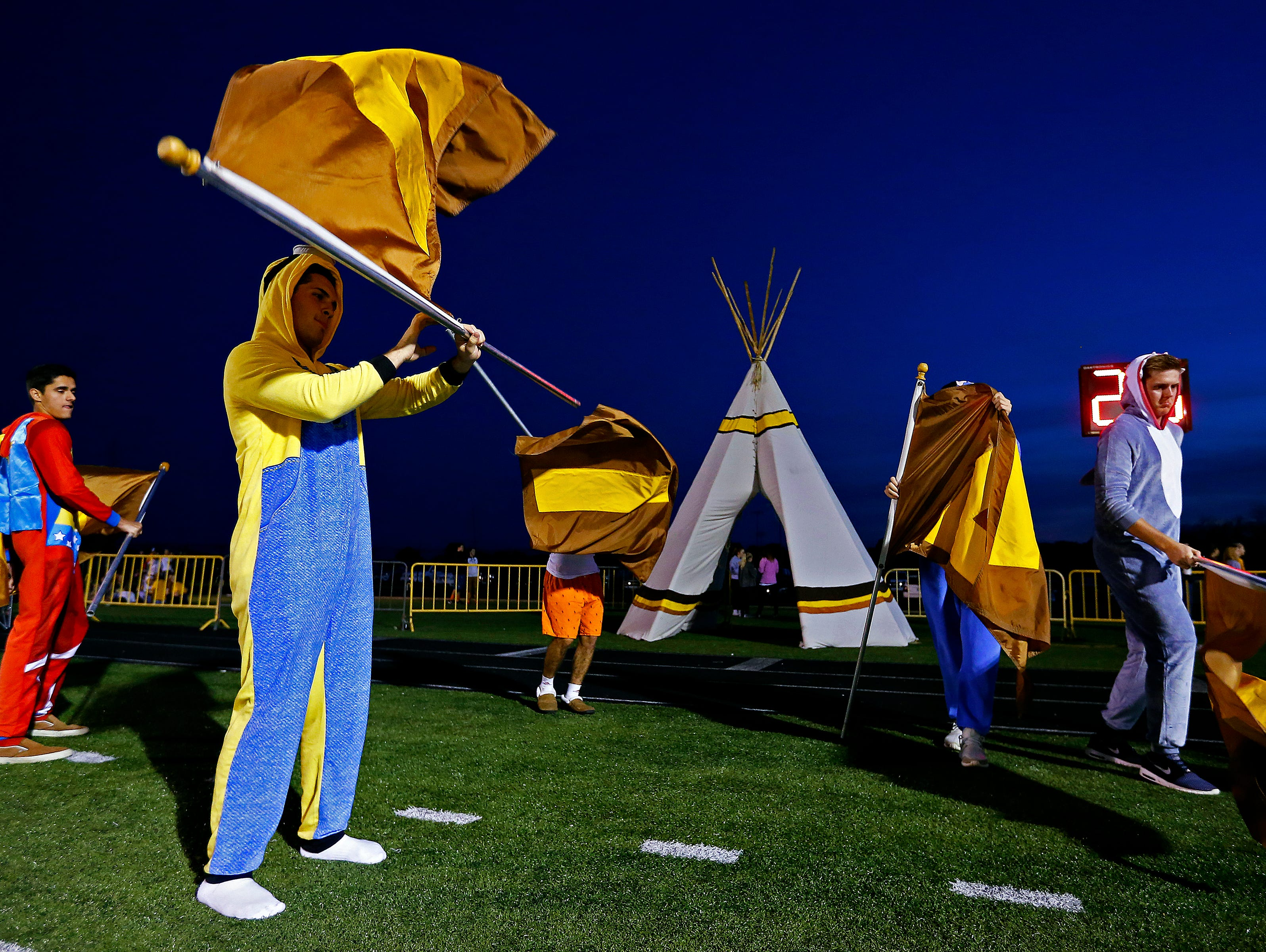 Kickapoo High School students wait for the team's entrance to the field prior to the start of the Class 6 playoff game between Rockhurst High School and Kickapoo High School played at Pottenger Stadium in Springfield, Mo. on Oct. 28, 2016. The Rockhurst Hawklets won the game 26-3.