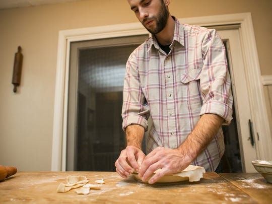 Dylan Freeman, the son of the couple behind Vermont Rolling Pin & Co, makes the pie crust for his award-winning apple pie in South Burlington, Vermont on Wednesday, November 16, 2016.