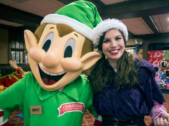 Mint the Elf and Katie Boggs make the rounds in the children's activity area of Christmas at The Galt House.