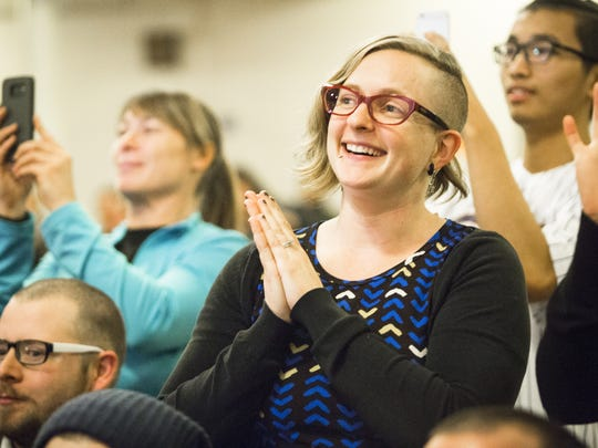 Ali Kuhlman applauds as Bernie Sanders speaks during his book tour stop at First Unitarian Universalist Society Meeting House in Burlington on Tuesday, November 22, 2016.