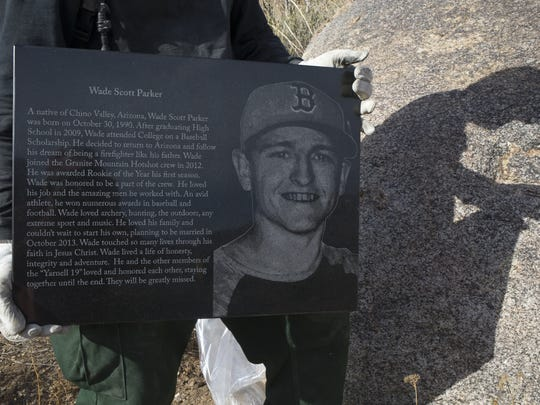 Jeremy Campbell holds the memorial plaque for Wade