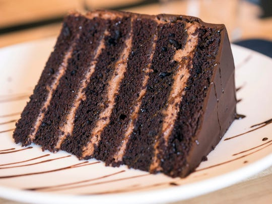 An enormous slice of multi-layered chocolate cake is the headliner from the dessert menu at Brooklyn and the Butcher. 11/17/16