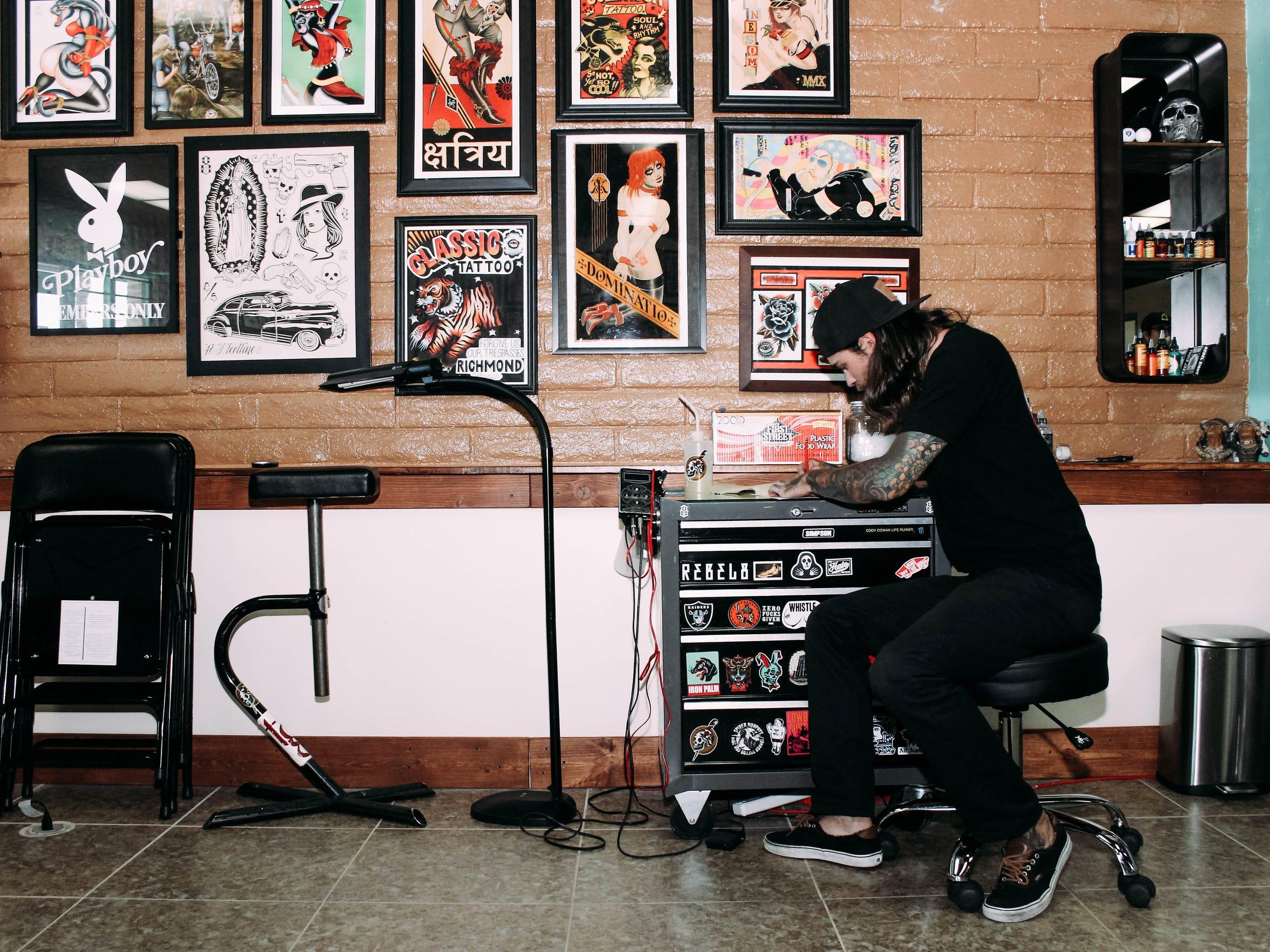 Cody Cowan at the Iron Palm Tattoo Parlour.