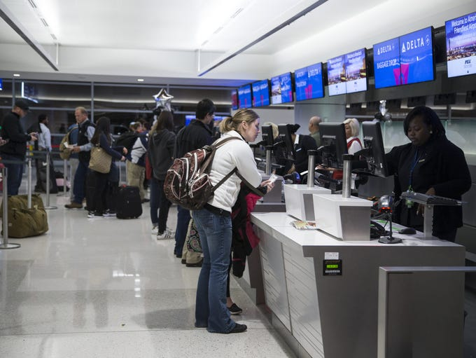 Passengers' check-in at the Delta ticket counters at