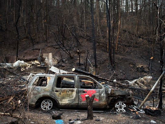 Dec 5, 2016; Gatlinburg, TN, USA; The remains of the home of Allan Rivera' are seen Monday. The family evacuated from their rental cabin before it was completely destroyed in last Monday's fires. Mandatory Credit: Andrew Nelles / The Tennessean via USA TODAY NETWORK
