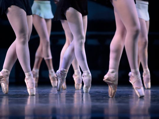 A close-up view of dancers performing during rehearsal