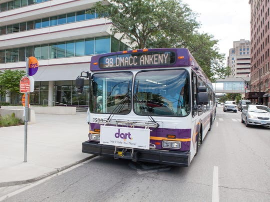 A DART bus picks up passengers in the Des Moines area. DART hopes to expand their services but metro cities are concerned about the costs.