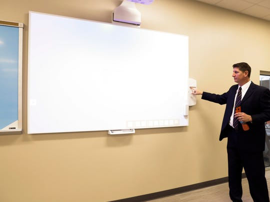Bryan Glatter, vice chancellor of administration and finance, operates a short-throw projector and smartboard inside a classroom in the new Health and Sciences building at South Louisiana Community College in Lafayette Dec. 8, 2016.