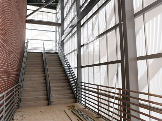 An enclosed outdoor staircase covered with metal screens in the new Health and Sciences building at South Louisiana Community College in Lafayette Dec. 8, 2016.