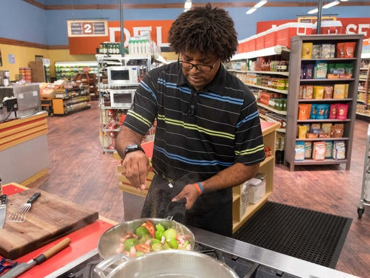 Contestant Stephen Jones sprinkles salt on his dish,