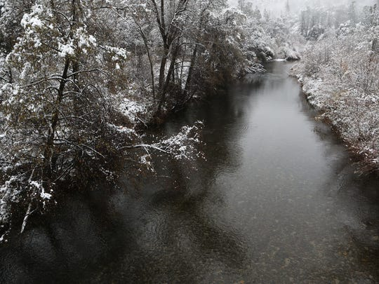 Snow covererd the banks of Clear Creek in Whiskeytown National Recreation Area Thursday morning.