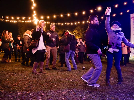 Dancers enjoy The Lost Bayou Ramblers during Christmas in the Park, Moncus Park at The Horse Farm in Lafayette Dec. 9, 2016.