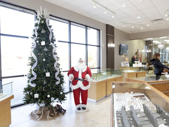 The holiday-decorated showroom of the Ashley Blue Jewelers in Youngsville Dec. 9, 2016.