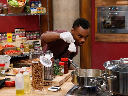 """Cedrick Miller cooks during the baseline challenge, as seen on Food Network's """"Worst Cooks in America."""""""