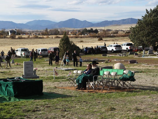 Lance and Carol Hopkins wait for the procession to arrive for the funeral of their son, Modoc County sheriff's deputy Jack Hopkins, in November at the Little Shasta Cemetery near Montague.
