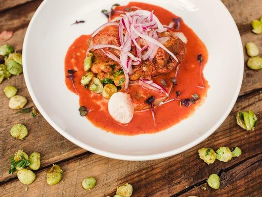 636184354290234122-Cochinita-Pibil-celebration-dish---photo-credit-Mayan-Cafe.jpg