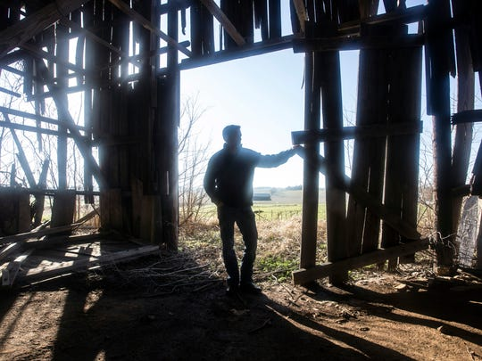 Brian Luftman stands on property his company American