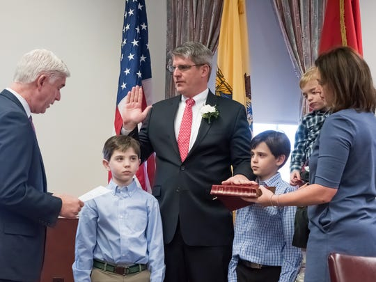 Assemblyman Kevin J. Rooney administering the oath of office to Wyckoff Committeeman Timothy Shanley during the township's reorganization meeting Sunday. Pictured are his sons Brian; Matthew and T.J. His wife, Melissa, held the Bible.