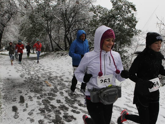 In January 2017, people participate in the Frosty Fun Run along the slushy Sacramento River Trail in Redding.