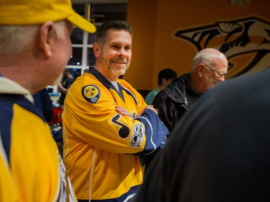 Dennis K. Morgan speaks with fans before singing the national anthem at the Nashville Predators game at Bridgestone Arena on Jan. 12, 2017.