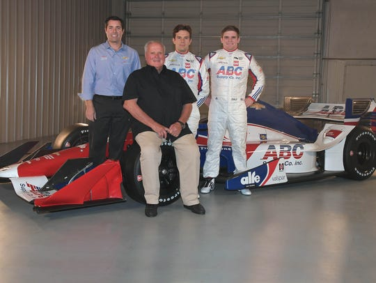 A.J. Foyt with drivers Carlos Munoz and Conor Daly.