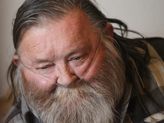 Charles Plank sits in his room Tuesday at the Americana