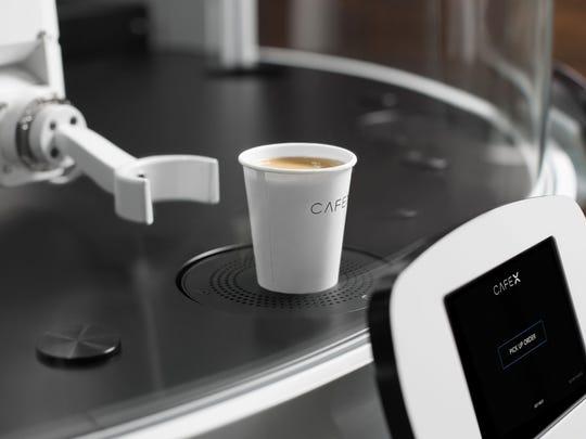 Cafe X's robotic barista.