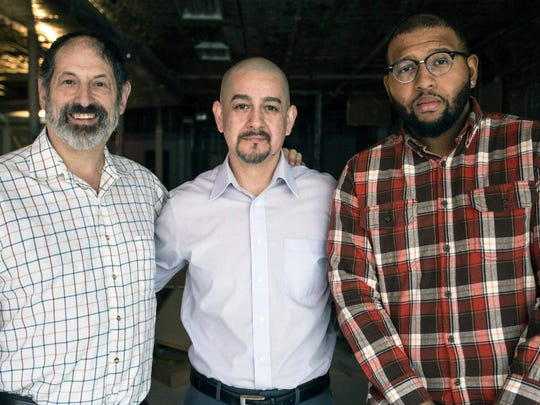 """Building owner James Reskin, studio owner Hugo Diaz, and producer Ricky """"Boom"""" Wiggington, Jr stand in the open space at 520 Fourth Street. The trio are converting the century-old building to house post-production and recording facilities. 1/29/17"""