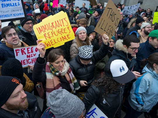 Protesters assemble at John F. Kennedy International