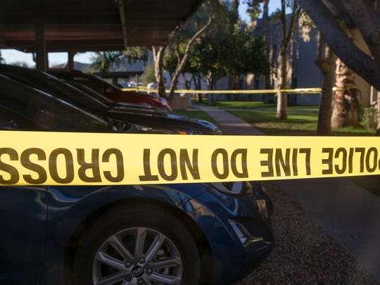 Phoenix police said a mother was shot dead while loading her two children into a car around 6 a.m. at a north Phoenix apartment complex on Jan. 31, 2017. Neither of the children were harmed.