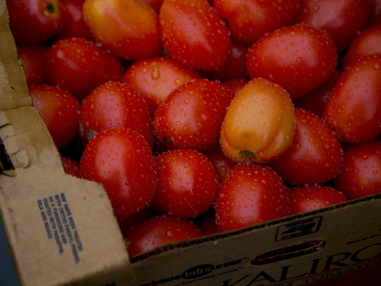A box of roma tomatoes are part of the rescued produced