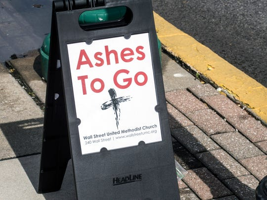 An Ashes to Go site was set up at the corner of Spring