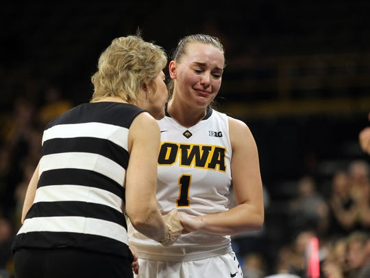 Iowa's Alexa Kastanek heads to the bench in the final moments of the Hawkeyes' WNIT Elite Eight game against Washington State at Carver-Hawkeyes Arena on Sunday, March 26, 2017.