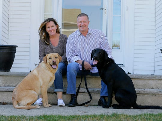 Scott and Nicole Brandle, owners of River Run Pet Sitters/Ocean Walk Pet Sitters, a Shrewsbury/Brick based business which provides a long range of pet care services, sit with their dogs, Ripley and Cooper, at their home in Brick.
