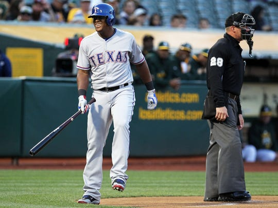 Adrian Beltre of the Rangers steps out of the batters' box, a far-too-common occurrence.