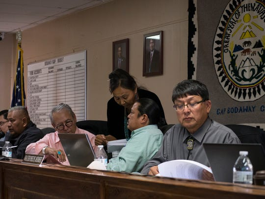 Walter Phelps (right), committee board member, reads documents during a Resources and Development Committee special meeting on Jan. 11, 2017, at the Bodaway-Gap chapter house.