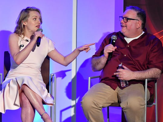 Actress Elisabeth Moss left, and show runner-producer Bruce Miller discuss the challenge of translating a classic dystopian novel into a television series in the Television Academy Foundation's alumni and networking event, 'The Handmaid's Tale -- From Script to Screen' at the Saban Media Center on Thursday, March 30, 2017 in North Hollywood, Calif.