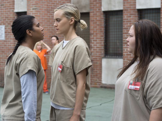 Jessica Pimentel, left, Taylor Schilling (middle) and new arrival Jolene Purdy mix it up at Litchfield prison for Season 4 of Orange Is the New Black.
