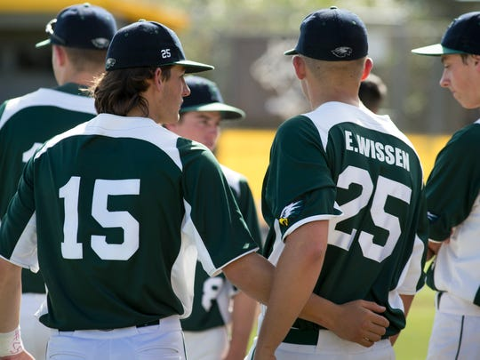 Flagstaff High School baseball player Hunter Darris (2nd from right) wore Evan Wissen jersey (25), May 2, 2017, during their state baseball playoff game against Marcos de Niza.