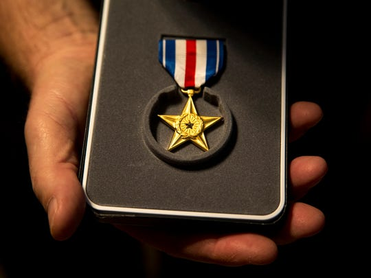 Bruce Shearer holds his Silver Star, May 5, 2017, in