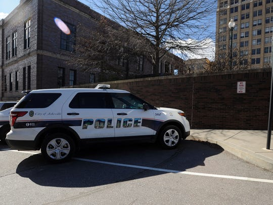 An Asheville Police Department vehicle next to the