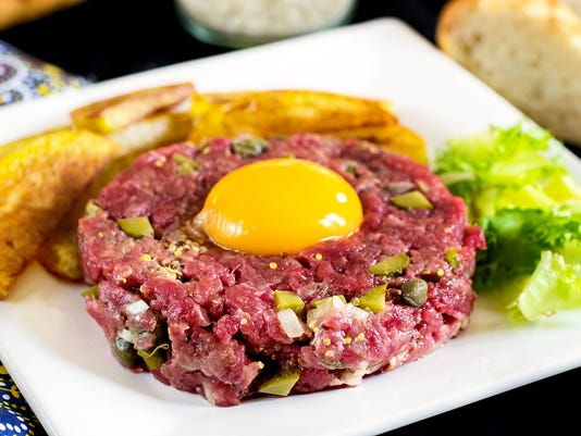Raw beef steak tartare with French fries
