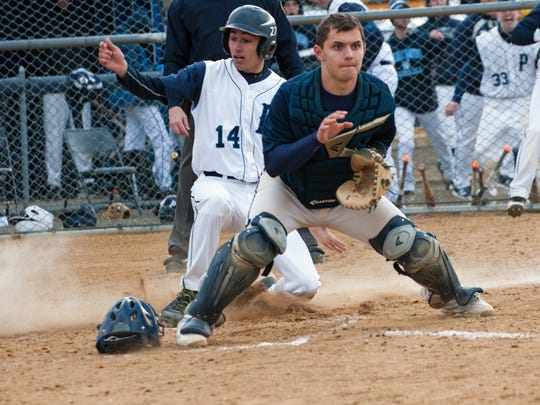 Catcher Matt Paiotti (right) and Indian Hills are focused on the North 1, Group 3 baseball tournament.