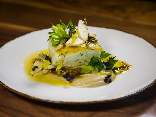 This is the roasted halibut from Mora Italian, an upscale