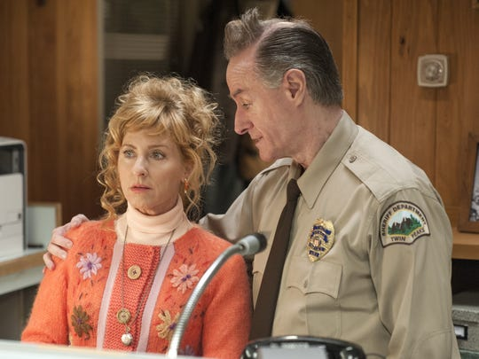 Receptionist Lucy (Kimmy Robertson), left,  and deputy